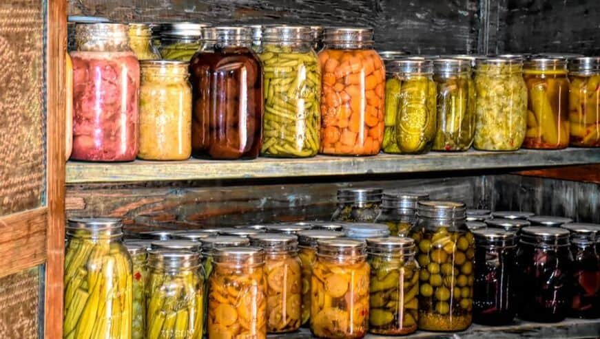 canned vegetables in jars in a root cellar