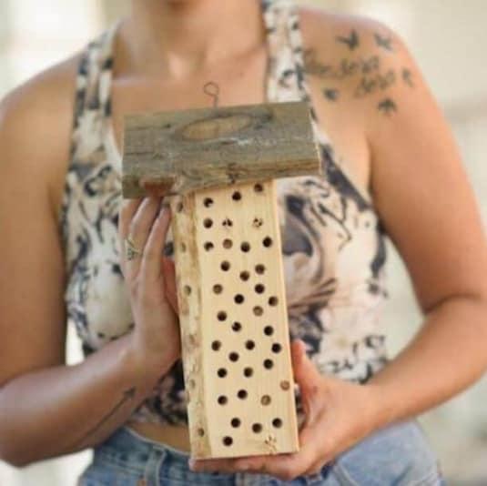 woman holding mason bee house