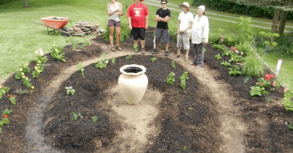 community gardeners with spiral bed and olla